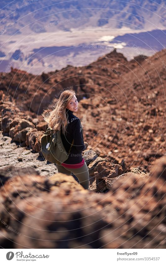 Young woman hiking the Teide Volcano in Tenerife, Canary Islands, Spain outdoors islands park volcanic blue volcano national rock through clouds nature travel