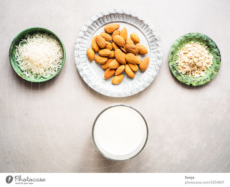 Ingredients for almond, rice and oat milk Food Dairy Products Rice Almond Oat flakes Milk almond milk Nutrition Breakfast Organic produce Vegetarian diet