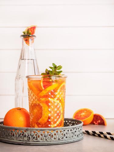 Orange slices in a glass of water Food Mint Organic produce Diet Beverage Cold drink Drinking water Lemonade Juice Longdrink Cocktail Bottle Glass Straw