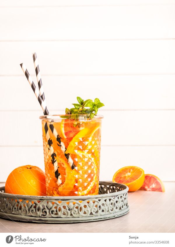 Summer drink with fresh oranges and peppermint Orange Herbs and spices Mint Organic produce Diet Beverage Cold drink Drinking water Lemonade Juice