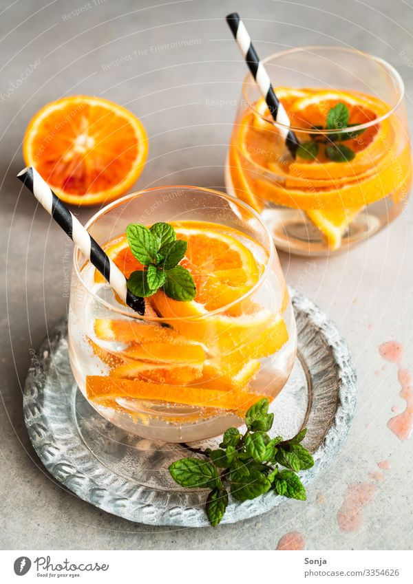 Summer drink with fresh oranges in a glass Fruit Herbs and spices Mint Orange Beverage Cold drink Drinking water Lemonade Alcoholic drinks Longdrink Cocktail
