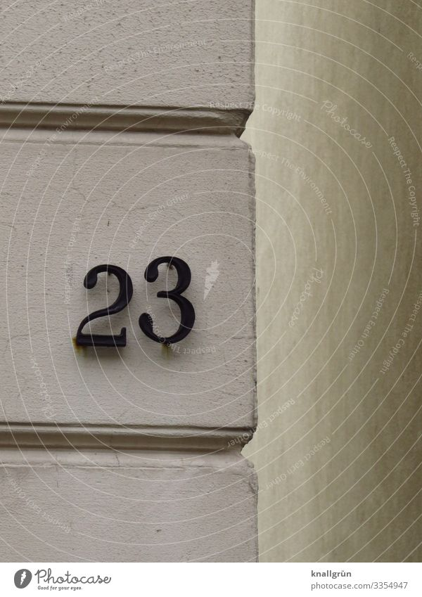 23 Town House (Residential Structure) Wall (barrier) Wall (building) House number Sign Digits and numbers Communicate Gray Black White prime Old building