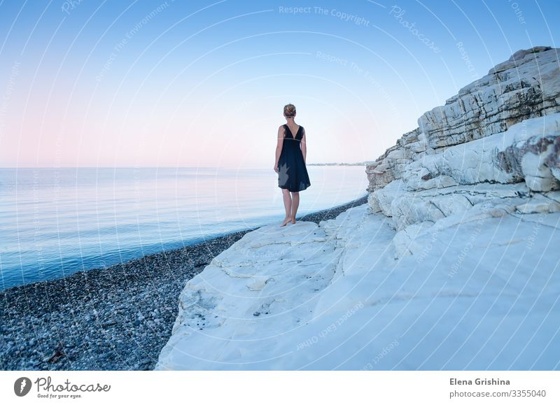 A lonely girl in a black dress on the seashore. White rocks. Beautiful Ocean Woman Adults 18 - 30 years Youth (Young adults) Nature Landscape Summer