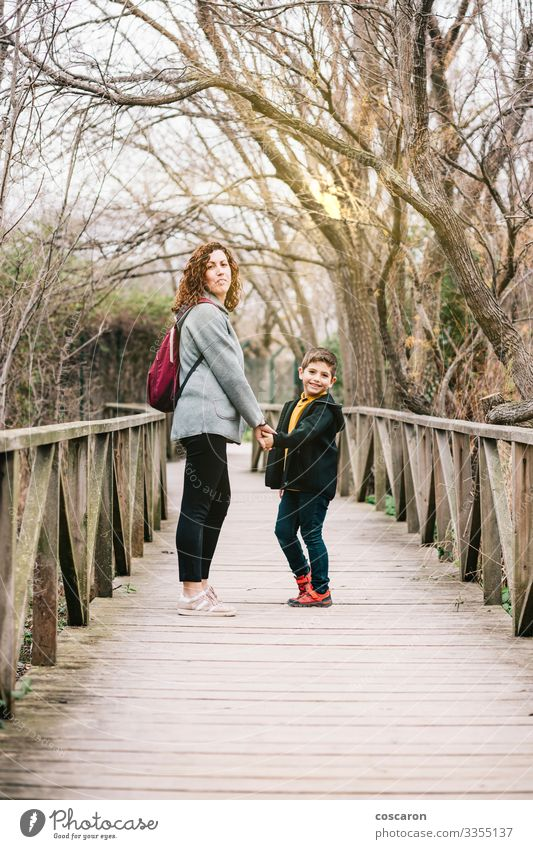 Mother and son crossing a bridge together Lifestyle Joy Happy Beautiful Healthy Leisure and hobbies Vacation & Travel Tourism Adventure Freedom Summer Mountain