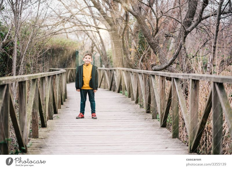 Lonely kid in the middle of a bridge Lifestyle Joy Happy Relaxation Leisure and hobbies Vacation & Travel Tourism Adventure Hiking Child Human being Masculine
