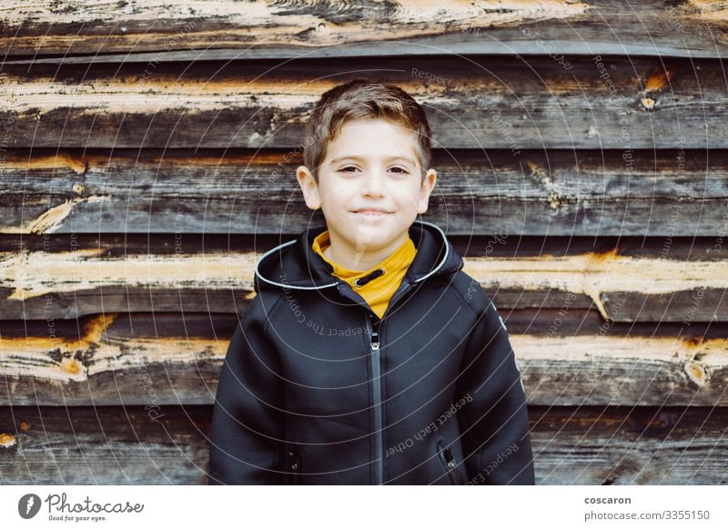Portrait of a beutiful kid with a wooden background Lifestyle Style Happy Beautiful Vacation & Travel Child Human being Masculine Toddler Boy (child) Infancy 1