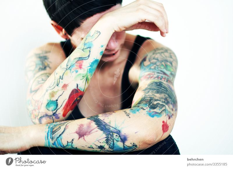 Emotional Woman Adults Body Skin Head Hair and hairstyles Face Nose Arm Hand 30 - 45 years Tattoo Piercing Exceptional Muscular Beautiful Eroticism
