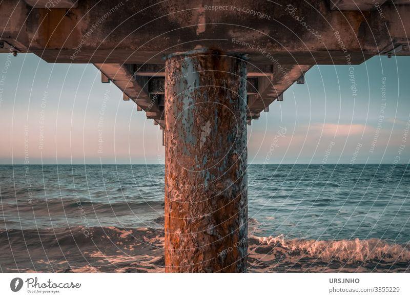 rusty pier from below Sky Summer Beautiful weather Waves Baltic Sea Ocean Rust Infinity Maritime Blue Brown Pink Calm Wanderlust Symmetry Sea bridge Symetric