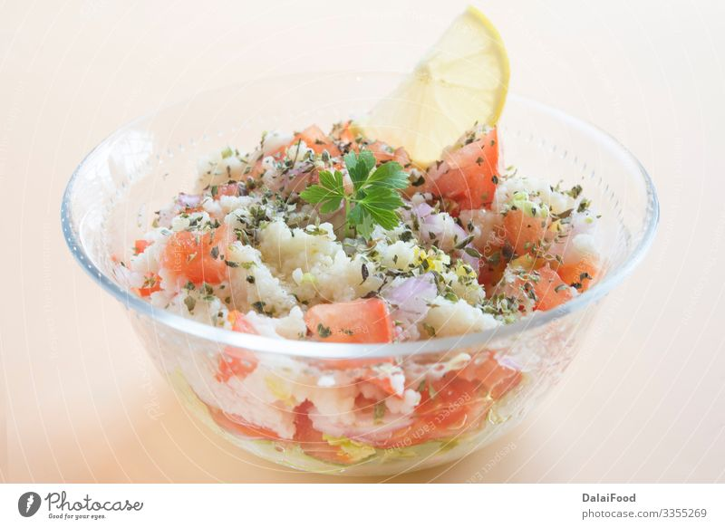 Traditional oriental salad Tabbouleh in bowl Diet Bowl Tabbouli Arabia arabic brown background cilantro couscous cucumber iraqi Israeli Lebanese Lemon oil Onion