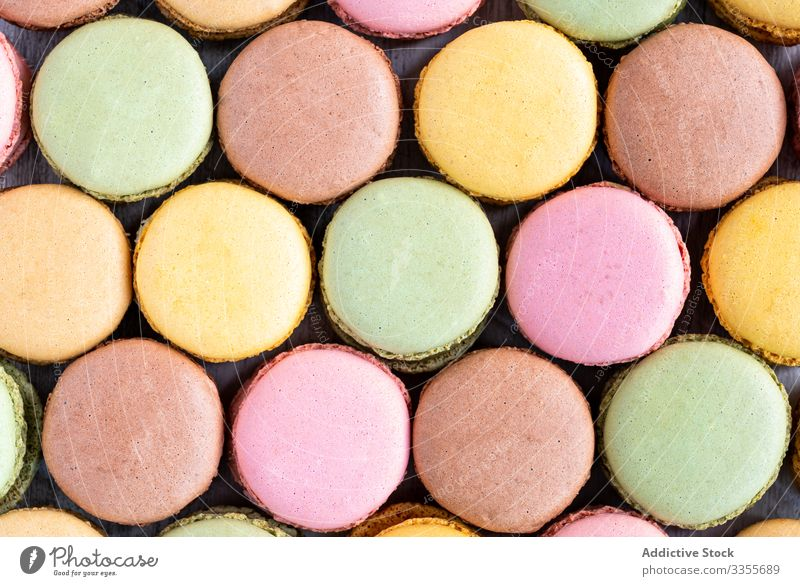 Fresh crunchy macaroons stack dessert colorful snack food wooden biscuit sweet gourmet assorted pastry confection traditional delicious tasty yummy sugar