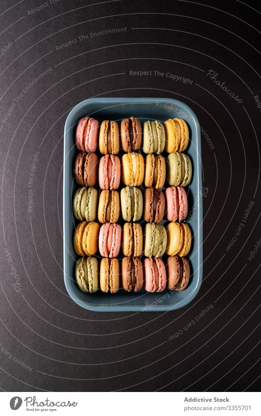 Fresh crunchy macaroons stack dessert container colorful snack food box biscuit sweet gourmet assorted pastry confection traditional delicious tasty yummy sugar