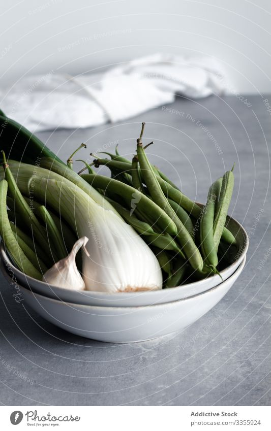 Green onion and garlic with green beans in bowl green onion vegetable food healthy ingredient nutrition cuisine diet raw organic fresh rustic kitchen vitamin