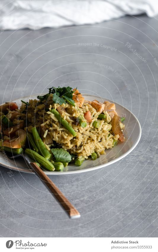 Delicious portions of dinner on table delicious tasty cooked dish rice green bean serve plate seasoning food meal cuisine lunch healthy gourmet fresh vegetable