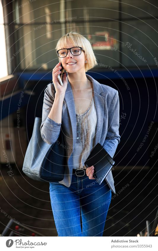 Blonde businesswoman talking on smartphone stylish young mobile connection communication conversation female professional person beautiful attractive