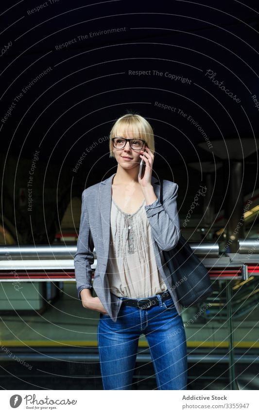 Blonde businesswoman talking on smartphone stylish young notepad mobile connection communication conversation female professional person beautiful attractive
