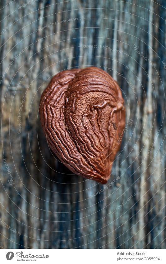 Half peeled hazelnut on table brown harvest ripe half wooden filbert gathering heap ingredient natural organic edible healthy raw seed food snack tasty seasonal
