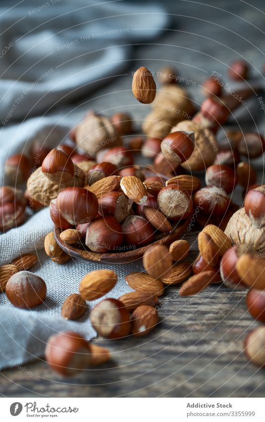 Brown ripe hazelnut on spoon at table brown healthy edible wooden filbert gathering heap ingredient natural harvest organic raw seed food snack linen tasty