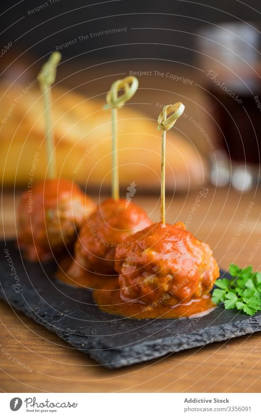 Delicious meat balls with tomato sauce on board meatball delicious bonded bamboo sticks food meal homemade gourmet dinner lunch cuisine dish recipe minced