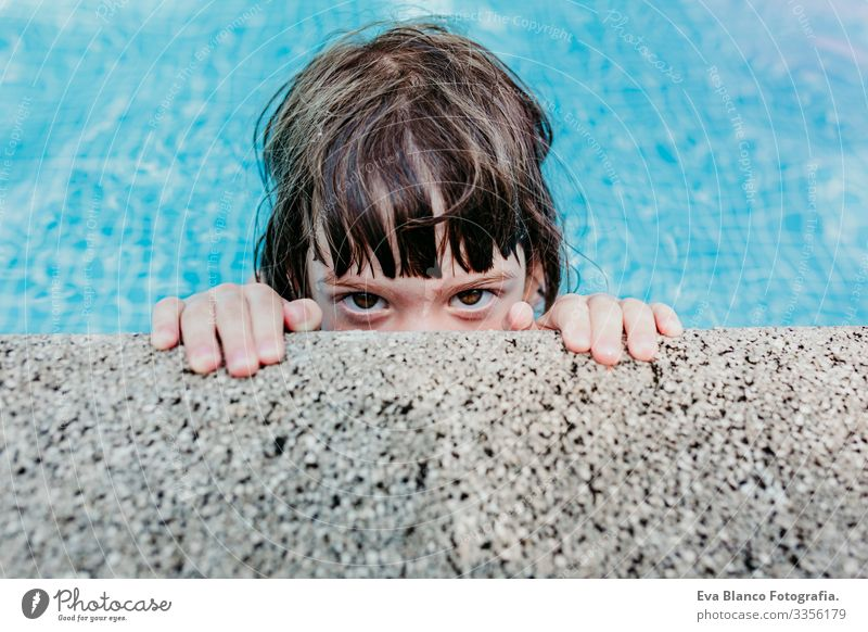 portrait of a beautiful kid girl in a pool. Smiling. Fun and summer lifestyle Action Swimming pool Beauty Photography Exterior shot Youth (Young adults)