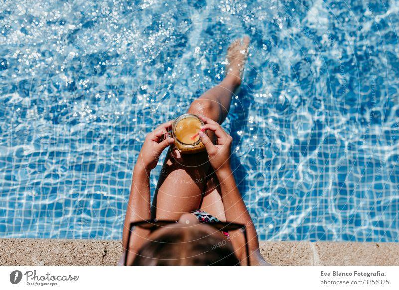 beautiful kid girl at the pool, summer time Sunlight Day orange drink Exterior shot young Swimwear water enjoyment swimming kids Caucasian Playful Blue Smiling
