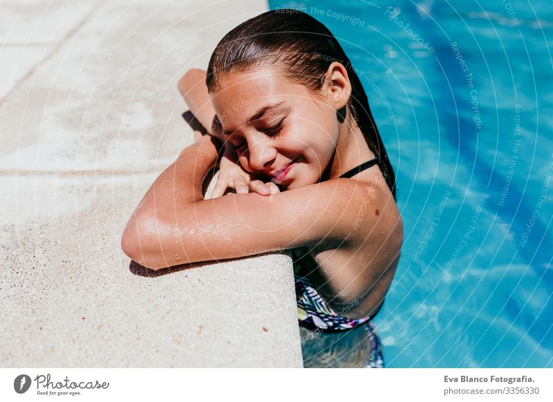 beautiful kid girl at the pool, summertime Sunlight Day Exterior shot young Swimwear water enjoyment swimming kids cheerful Action Playful Caucasian healthy
