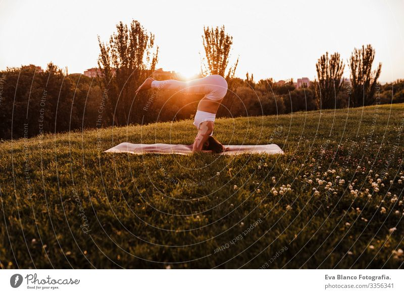 young beautiful asian woman doing yoga in a park at sunset. Yoga and healthy lifestyle concept Youth (Young adults) Woman Summer Happy enjoyment Sports