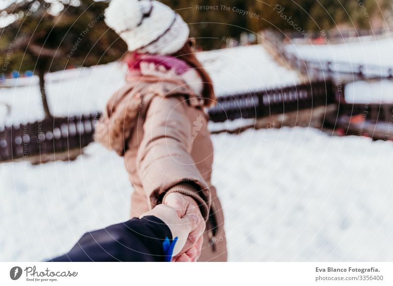follow me. woman and man holding hands. pov. winter season at the mountain. Love concept Woman Man Hand Snow Winter boyfriend girlfriend Hold Valentine's Day