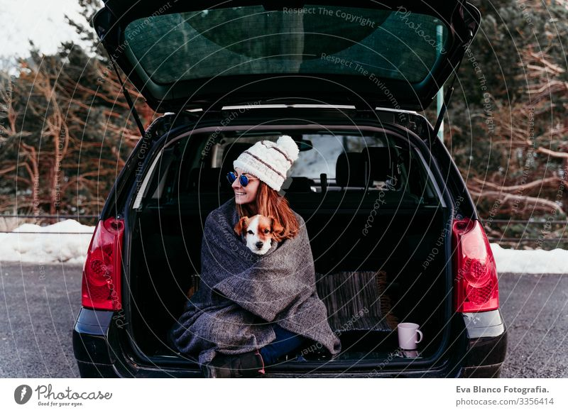 woman and cute jack russell dog enjoying outdoors at the mountain into the car. Travel concept. winter season Woman Dog Car Snow Mountain Exterior shot