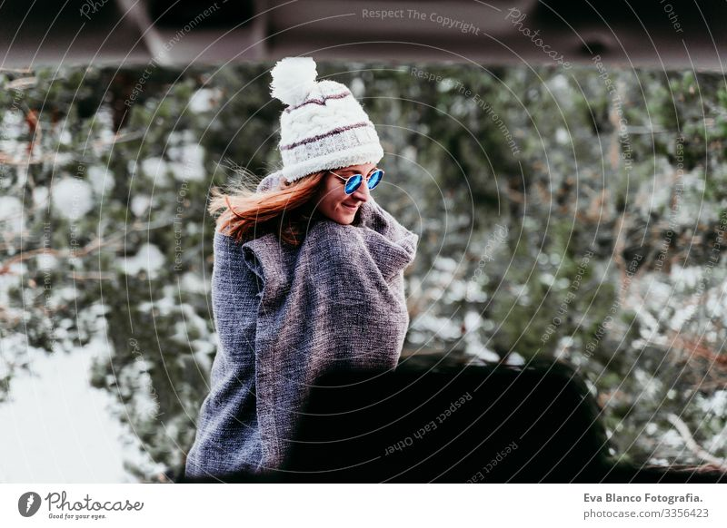 portrait outdoors at the mountain of young woman wearing winter clothes Portrait photograph Woman Snow Forest Hat Blanket Modern Relaxation Nature To enjoy