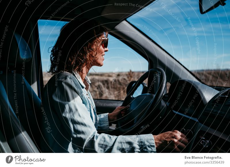 young beautiful woman driving a car. travel concept Woman Youth (Young adults) Driving Car Sunbeam Sunglasses Vacation & Travel Traveling Wheel Drive hire Share