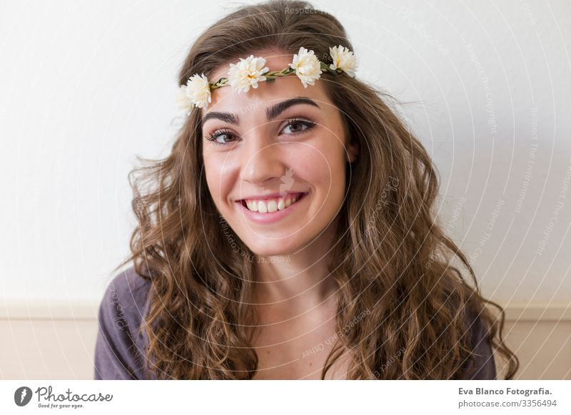 portrait of a young beautiful woman wearing a flowers wreath. She is smiling, indoors. Lifestyle Head Elegant Amazing Aromatic Considerate Eroticism Model