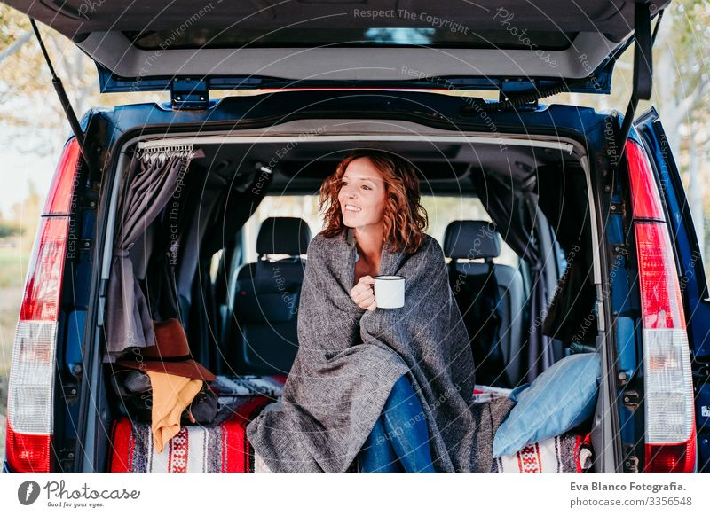 young beautiful woman drinking coffee or tea camping outdoors with a van. Travel concept Drinking Tea Coffee Teapot Woman Dog border collie Van van life
