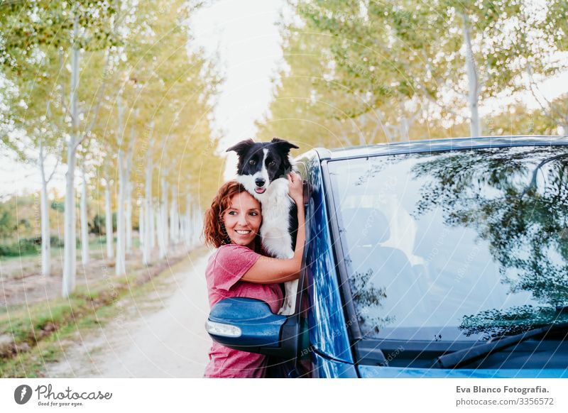 woman hugging her border collie dog in a van. Travel concept Woman Dog Van van life Vacation & Travel Traveling owner Youth (Young adults) Modern Autumn Spring