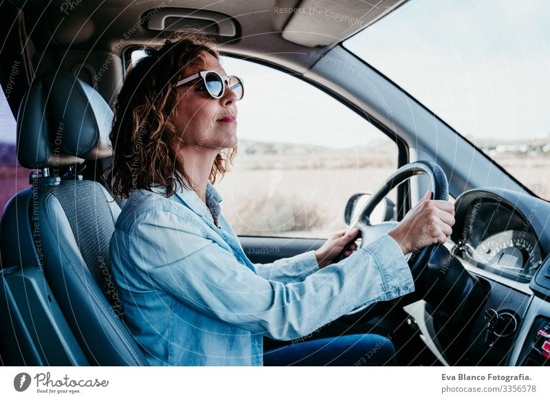 young beautiful woman driving a van. travel concept Woman Youth (Young adults) Driving Car Sunbeam Sunglasses Vacation & Travel Traveling Wheel Drive hire Share