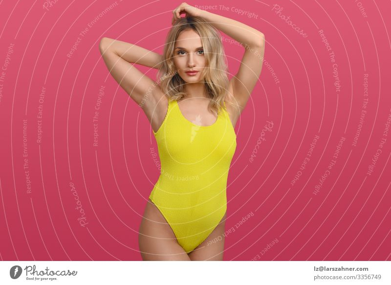 Beautiful sexy young woman in yellow swimsuit Style Body Vacation & Travel Feminine 1 Human being 18 - 30 years Youth (Young adults) Adults Fashion Stand