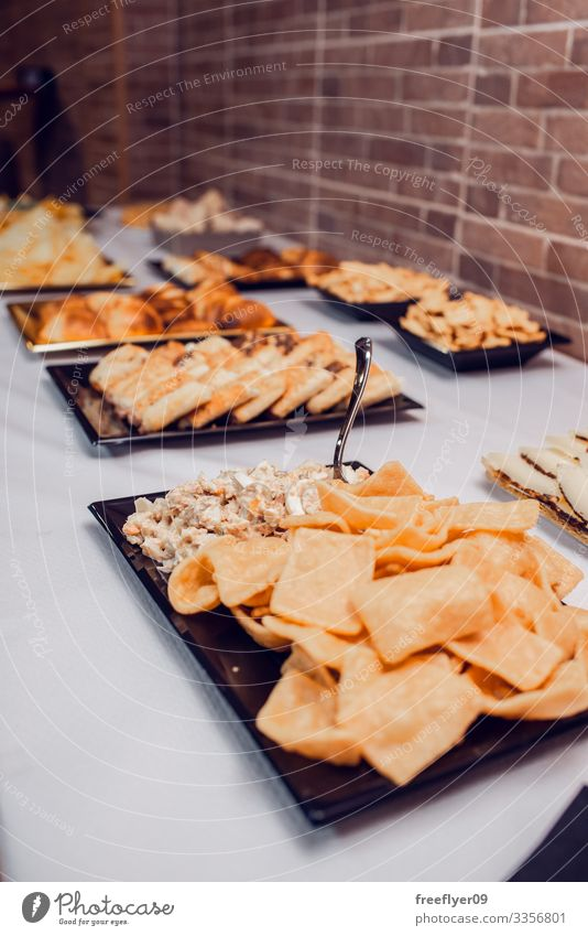 Table of snacks for a party lunch white counter table buffet holiday appetizer decoration food line service anniversary banquet dining eat dish desert cater