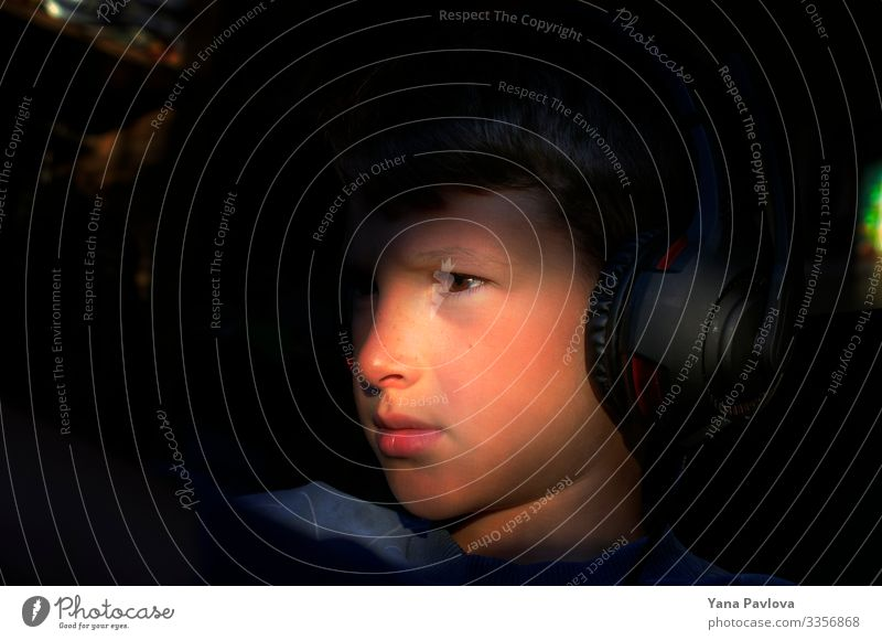Boy in headphones, young blogger Human being Baby Boy (child) Face 1 8 - 13 years Child Infancy Listen to music Work and employment Catch Listening Study Sit