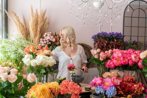 Beautiful blonde florist woman creates a wonderful bouquet Human being Woman Adults 1 18 - 30 years Youth (Young adults) 30 - 45 years Spring Plant Flower Rose