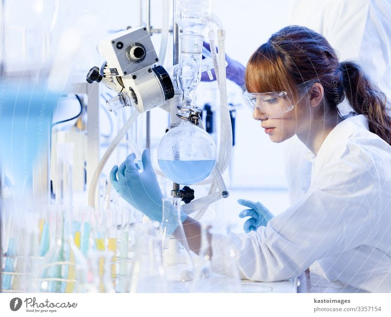 Young female chemists researching in life science laboratory. Health care Medication Science & Research Laboratory Examinations and Tests Work and employment