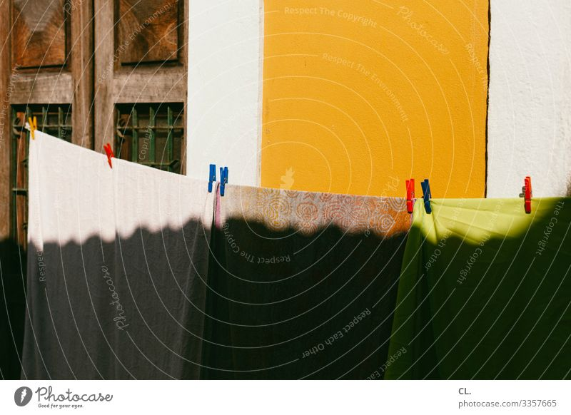 clothesline Wall (barrier) Wall (building) Laundry Clothesline Clothes peg Towel Esthetic Happiness Warmth Multicoloured Dry Colour photo Exterior shot Deserted