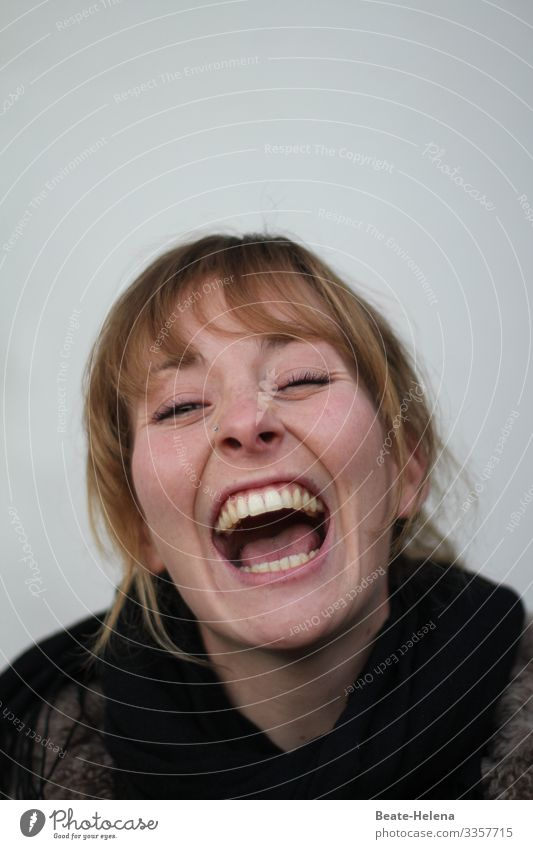Laughing and crying lie close together: young woman with open mouth lets her emotions run free Young woman Emotions emotionally Mouth open Laughter Cry Energy