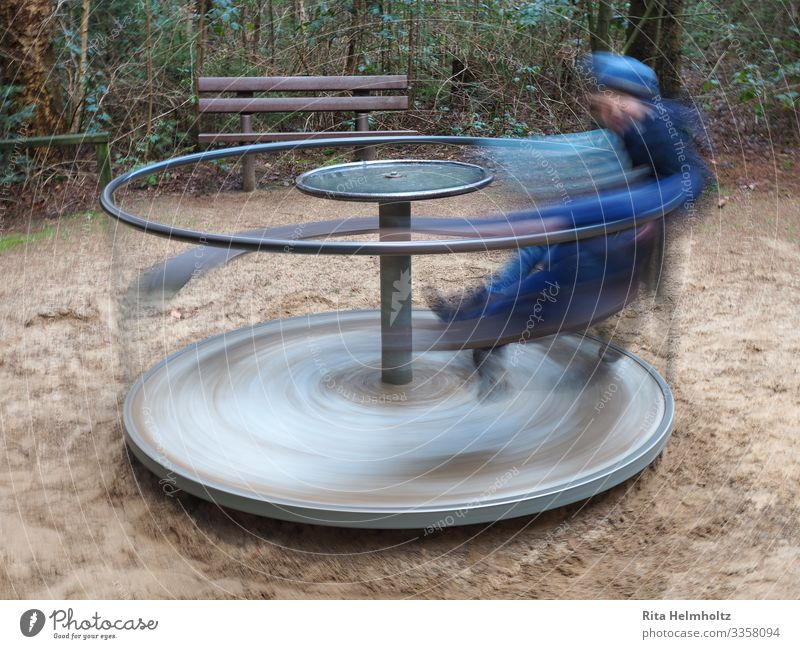Game Carousel Playing Children's game Parenting Boy (child) 1 Human being 3 - 8 years Infancy Toys Rotate Romp Happiness Speed Athletic Wild Blue Brown Joy