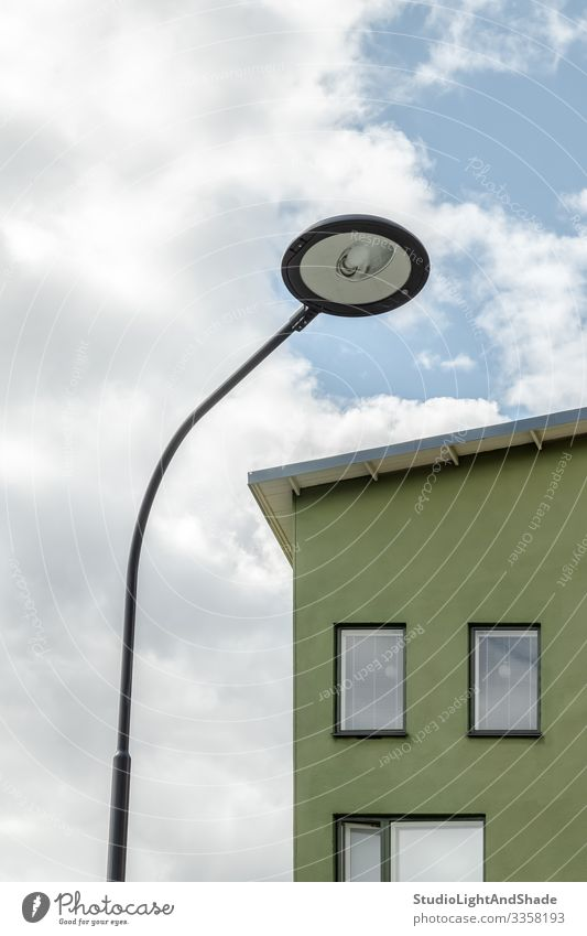 Streetlamp and facade of a green house Lifestyle House (Residential Structure) Lamp Environment Sky Clouds Town Building Architecture Facade Simple Modern New