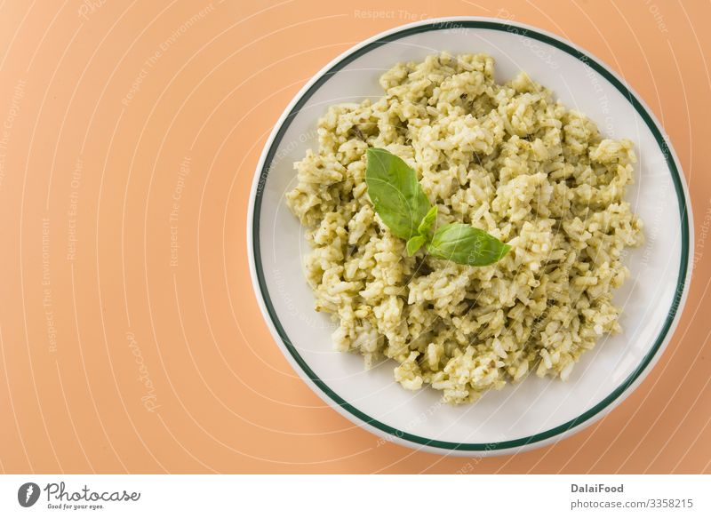 Rice with basil pesto sauce Lunch Vegetarian diet Plate Tradition Basil brown background Cooking Coriander ecuatorian rice food Gourmet green rice healthy