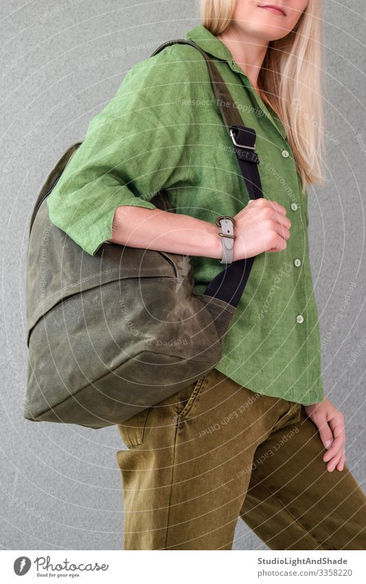 Woman in green clothes holding backpack Beautiful Summer Human being Young woman Youth (Young adults) Adults Fashion Clothing Shirt Pants Jeans Blonde