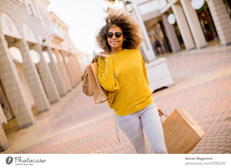Young black woman with curly hair in shopping Lifestyle Shopping Style Happy Beautiful Hair and hairstyles Human being Young woman Youth (Young adults) Woman