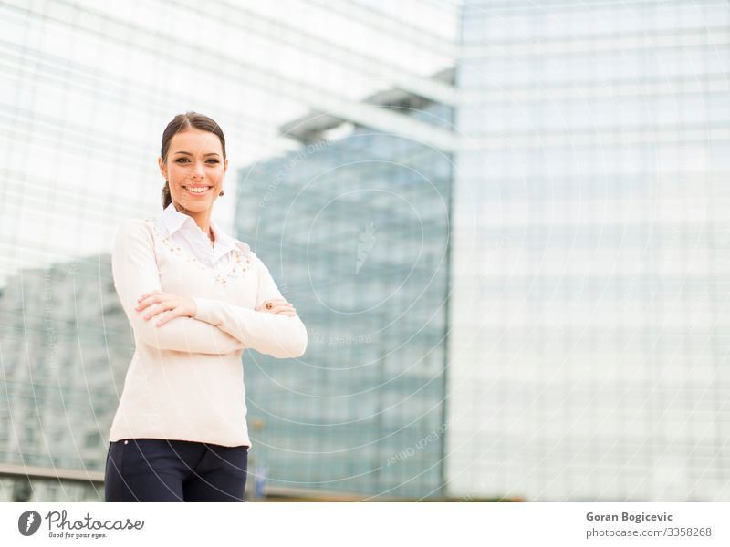 Young business woman in front of office building Lifestyle Style Happy Beautiful Success Office Business Career Human being Young woman Youth (Young adults)