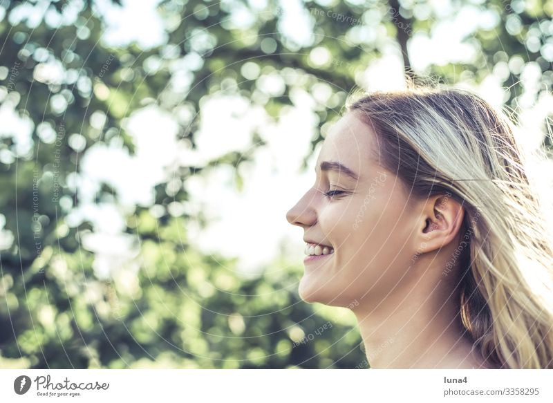 laughing young woman Woman relaxed enjoy glücklich cheerfully deceleration Fun sunbathe youthful Young woman left Joy Relaxation time-out Laughter lächeln
