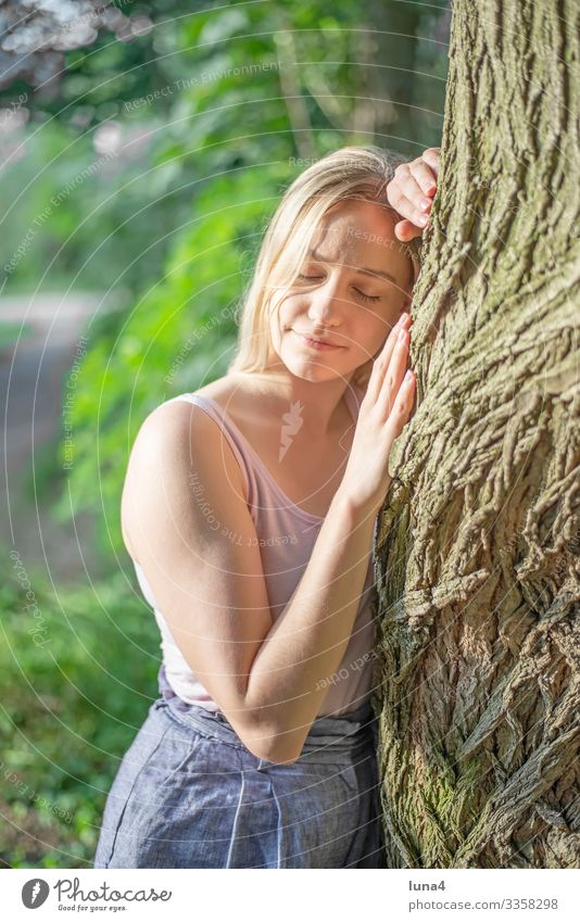 happy young woman hugs tree Woman Tree Embrace Stand relaxed Forest deceleration youthful Young woman left Relaxation time-out Meditative contented
