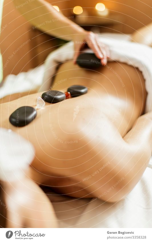 Hot stone massage therapy Lifestyle Beautiful Body Skin Medical treatment Relaxation Spa Massage Human being Young woman Youth (Young adults) Woman Adults Back